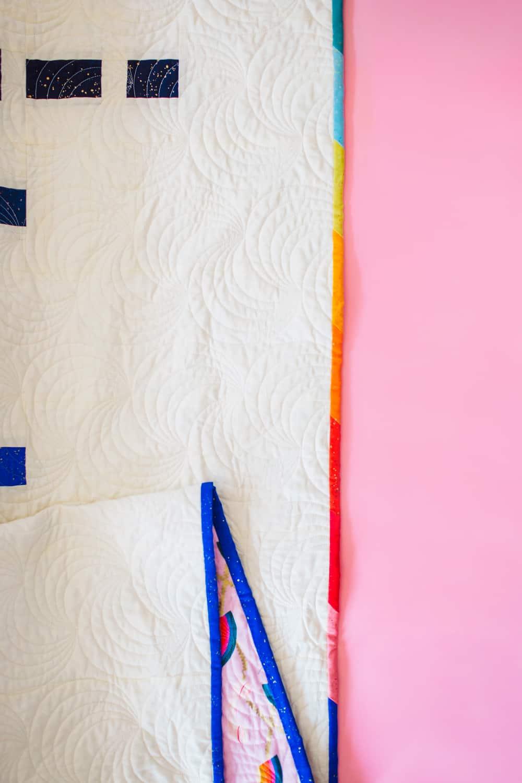 Rainbow Aftershock Detail Binding Shot - Aftershock Quilt from Wren Collective