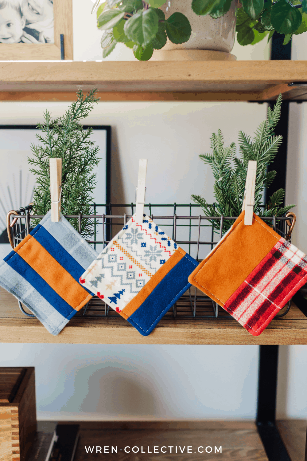 An image of three fabric scrap coasters hanging on a shelf. This free fabric scrap project tutorial is from Rachel of Wren Collective.