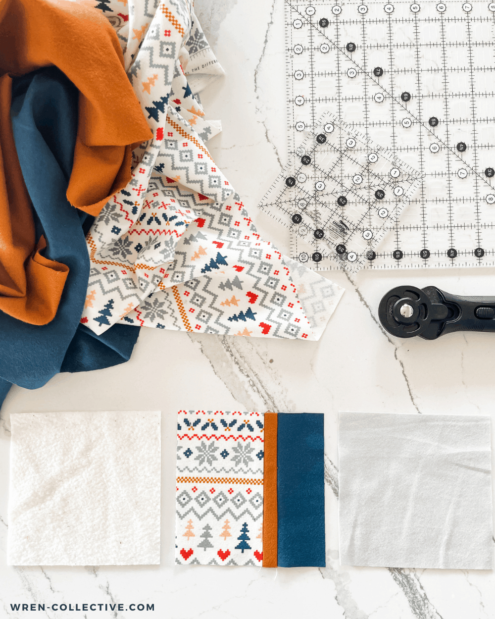 Scrap batting and scrap flannel are combined to make this fabric scrap project: a coaster! Batting, pieced coaster top, and scrap flannel backing are laid side by side in front of a rotary cutter, square rulers, and flannel fabric.